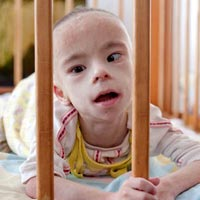 The American family adopts a child with special needs from the Kalinovka Orphanage