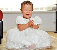 Mail Online: Smile that melts misconceptions: How Taya, who was born with Down's, became darling of the modelling world