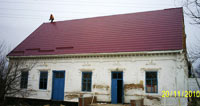 The  photo  report: a  new   roof for  a  little house for  children  with  special  needs!